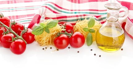 Photo of tagliatelle with cherry tomatoes,basil,oil,garlic at the top on white