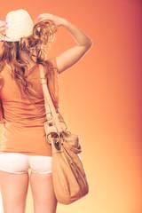 Fashionable woman with handbag. Summer fashion.