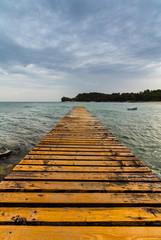 wood pier on the beach