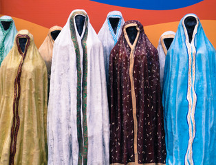 mannequins wearing robes ,chadors, abayas in many colors and patterns to cover women in traditional Muslim fashion on a street in Yaroslavl, Russia