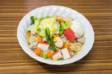 Noodles with vegetables and meat to eat healthy on wood table, Thai food