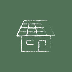 House with solar panel icon drawn in chalk.