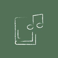 Music book icon drawn in chalk.