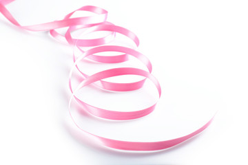 Pink silk ribbon isolated on white