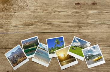 snapshots of travel destinations on wooden background