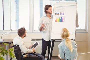 Businessman explaining multi colored graph