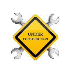 Under construction sign with two silver wrenches isolated  on white