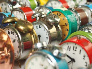 Group of colorful old alarm clocks