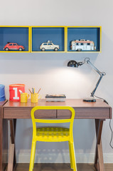 yellow chair and wooden desk with modern black lamp