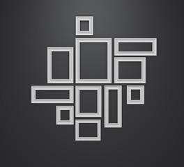 White frames on black wall