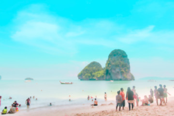 Blurred tourist on the beach : Holiday and summer background concept.