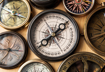 Wall Mural - Old compass on vintage wood
