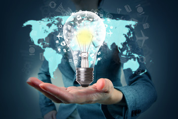 Light bulb in hand with application