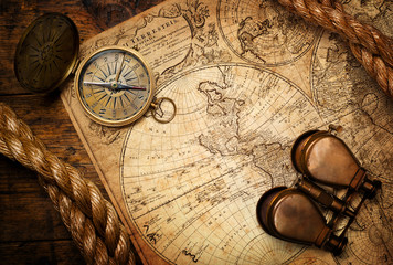 Fototapete - old compass, binoculars and rope on vintage map