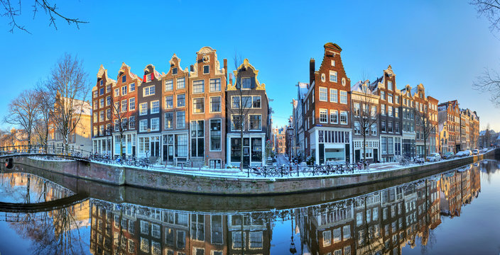 Beautiful early morning winter panorama of the Unesco world heritage city canals of Amsterdam, The Netherlands.
