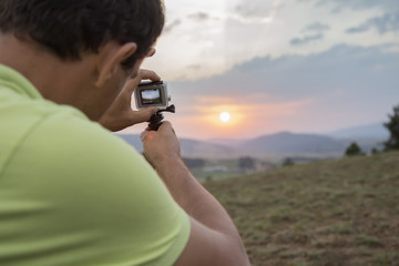 Taking a photo of a colorful summer sunset