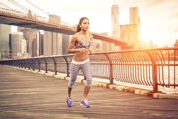 beautiful asian woman running in New york at sunset time.