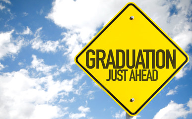 Graduation sign with sky background