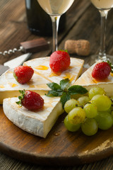 Cheese with strawberries and honey