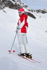 Female Skiing At Ski Resort