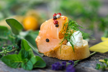 Slice of bread with smoked salmon, tapas