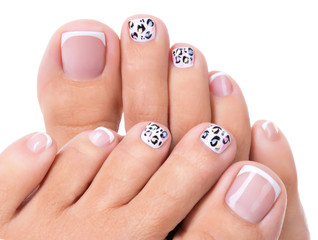 Beautiful woman's nails of legs with beautiful french manicure