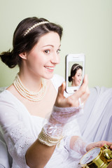 Happy girl in white lace dress smiling and making selfie