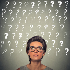 woman with puzzled face expression and question marks above her head