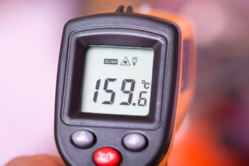 Yellow digital infra red thermometer.