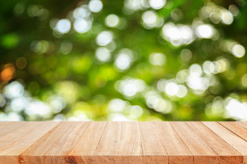 Empty top wooden table and sunny abstract blurred bokeh