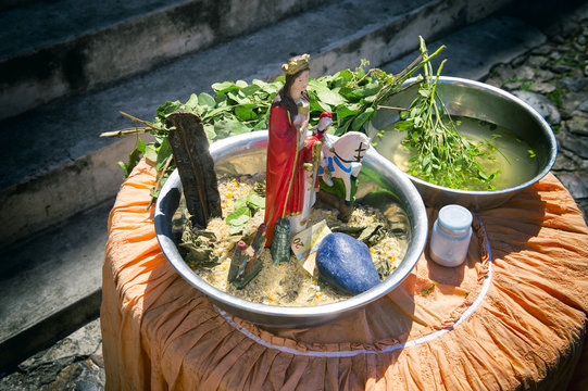 Leaves infused with sacred water wait on a table for use in candomble axé blessings in the tourist center of Pelourinho, Salvador, Bahia, Brazil