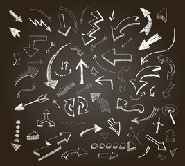 Hand drawn arrows icons set on a chalkboard