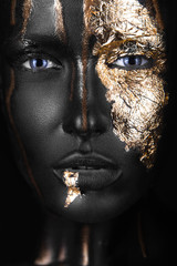 Foto op Aluminium People fashion portrait of a dark-skinned girl with gold make-up. Beauty face.