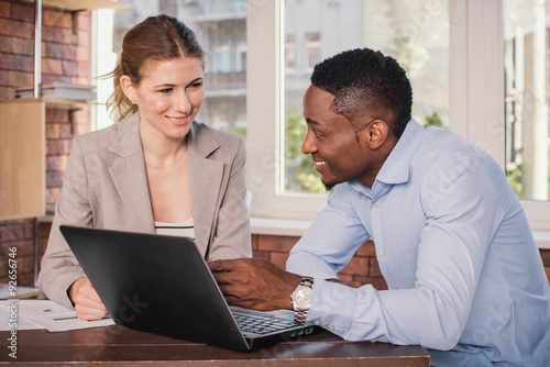 Two Business People Working Together Stock Photo And Royalty Free