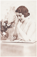 young girl  writting a letter