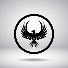 Silhouette of an eagle in a circle