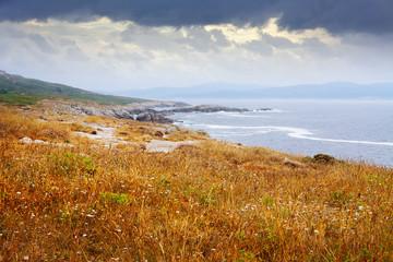 Autumn stone beach at ocean  coast