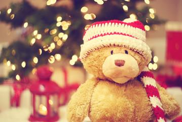 Bear wearing Santa hat with Christmas gift boxes