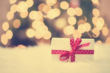 Christmas gift box on white carpet
