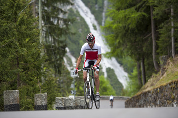 man road cycling uphill