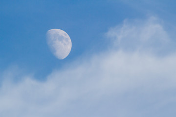 Moon, Clouds, and Blue Sky