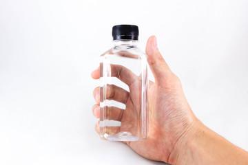 Hand holding full bottle of water