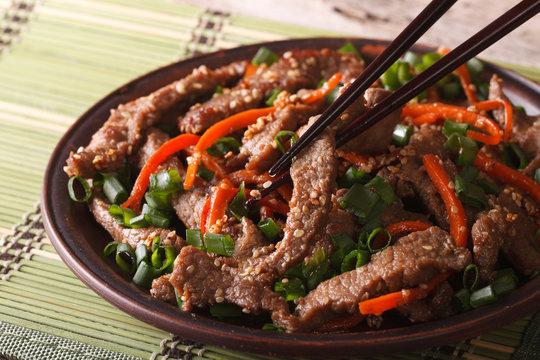 Korean bulgogi beef with carrot and onion closeup. horizontal
