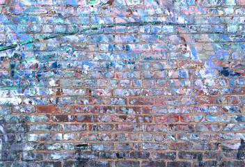 Grunge brick wall textured background with weathered blue paint