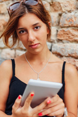 Portrait of a girl with a smartphone