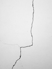 Crack on white wall background