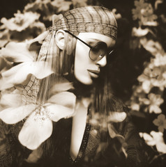Double Exposure Portrait of a Beautiful Hippie Girl and Flowers