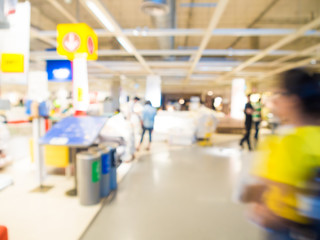 Blurred image of people shopping at mall of home decor