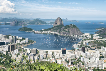 City skyline scenic overlook of Rio de Janeiro, Brazil with Sugarloaf Mountain, Botafogo and Guanabara Bay