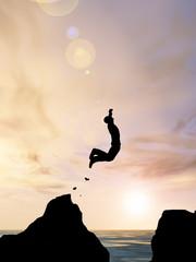 Human man silhouette jumping at sunset